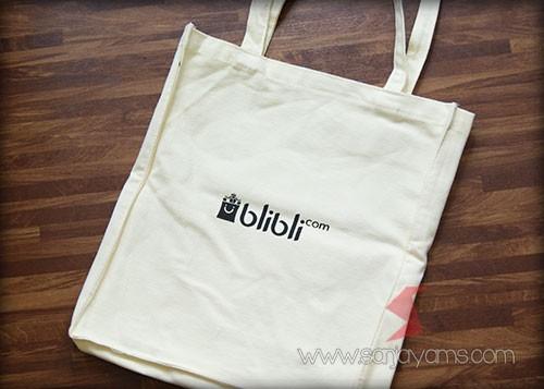 Cetakan sisi belakang tas rafel logo - Blibli