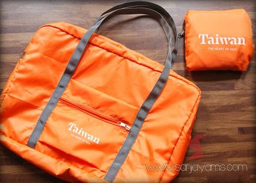 Travel bag lipat warna orange